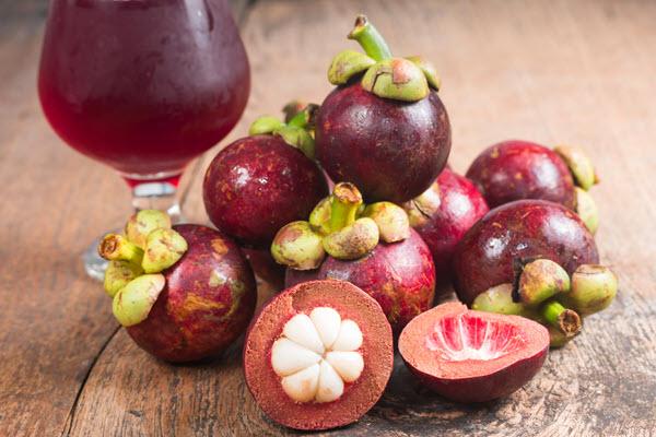 фото плодов и сока мангустина